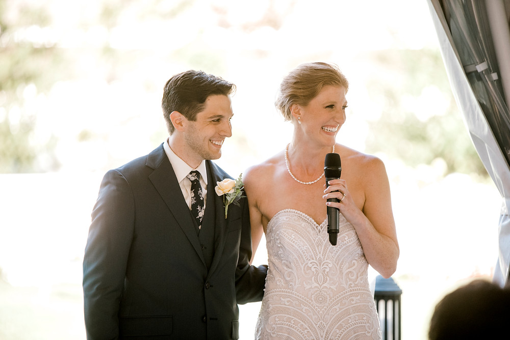 Couple who where just married, giving a speech to their guests at their wedding reception.