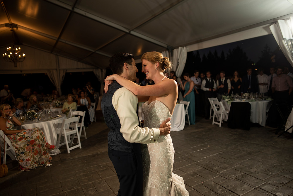 Couple who were just married celebrate with their first dance together as a married couple.