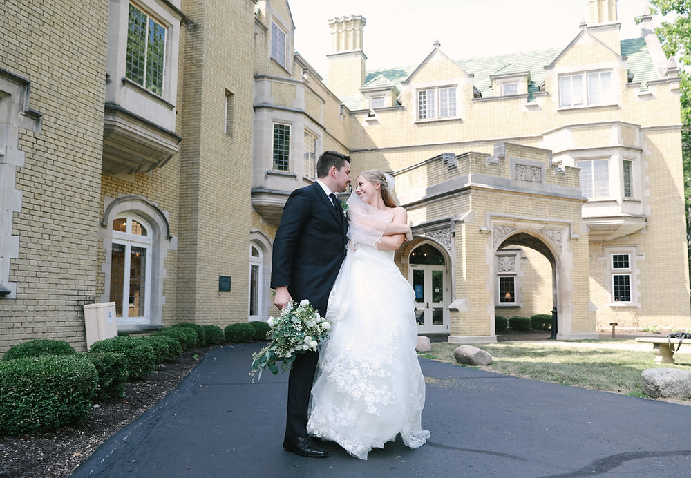 Picture of bride and groom standing in front of Laurel Hall