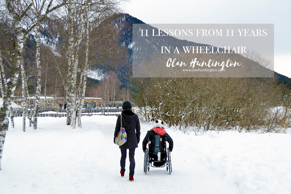 Two women, one in a wheelchair going through snow in Austria in winter