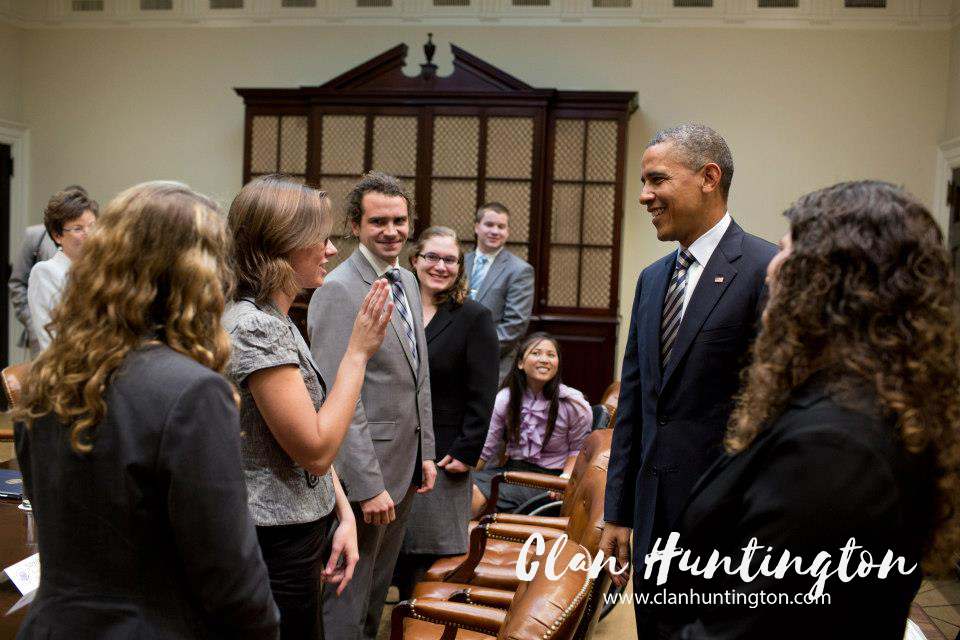 President Obama talking with students with disabilities. Woman in a wheelchair.
