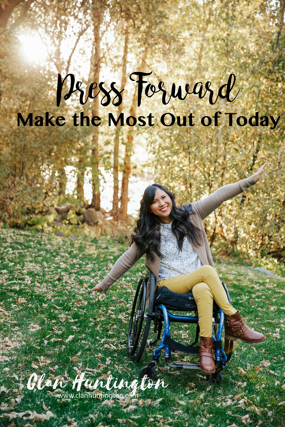 Asian woman in wheelchair in the forest in Utah in the fall
