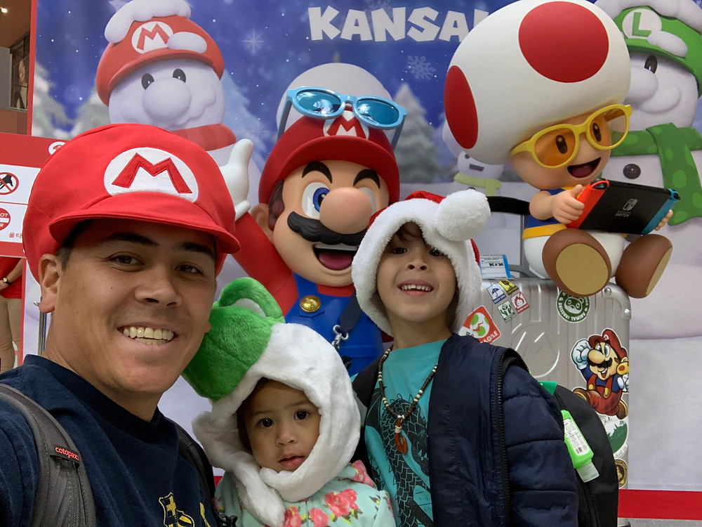 Dad and children with Mario costume and background in Japan