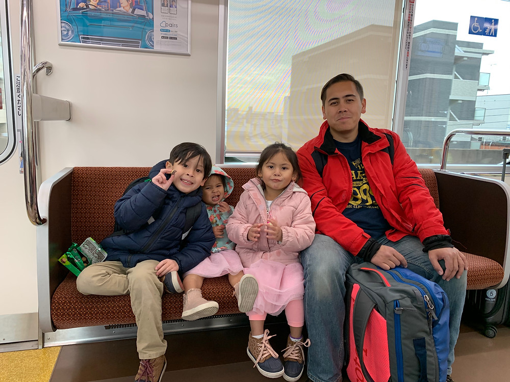 Asian family on train through Japan.