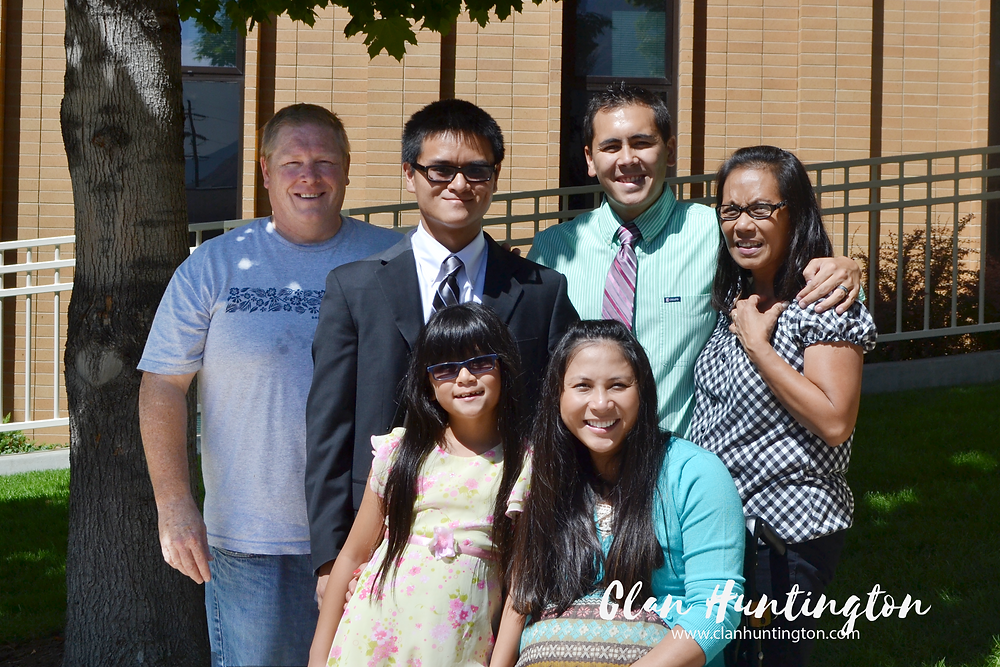 Interracial Asian family including woman in wheelchair taking group photo in front of brick building | Clan Huntington | missionary training center Provo UT