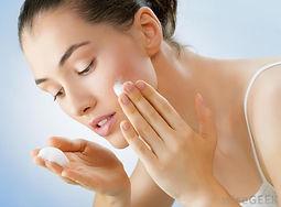 woman-applying-skin-cream-to-face.jpg