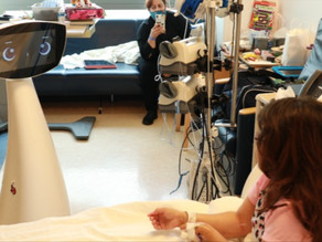 A visit from a social robot improves hospitalized children's outlook