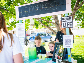 Two little girls run a lemonade stand to raise money for organ donations in Utah