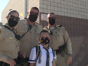 9-year-old boy escorted to school by Las Vegas police after father dies from COVID-19