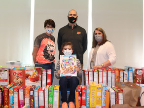 Students clap, shout as 1000+ donated cereal boxes turns into a huge domino run