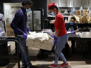 Teens at Dallas cafe make meal kits for needy amid COVID-19.