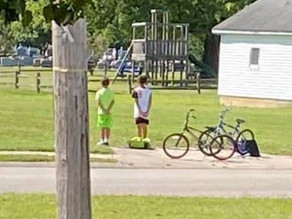 Moving moment as two boys hop off their bikes to pay respects at military veteran's funeral