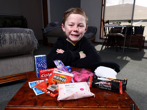 Jai Johns puts together packs for the homeless through A Little Helping Hand