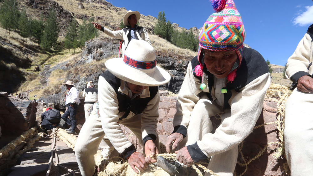 Peruvians rebuild ancient Incan rope bridge frayed during pandemic -- by weaving a new one