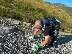 Amputee who lost both legs completes 13-hour crawl up Mount Snowdon