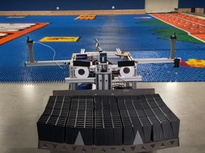 Robot breaks world record by arranging 100,000 dominos into mural in 24 hrs