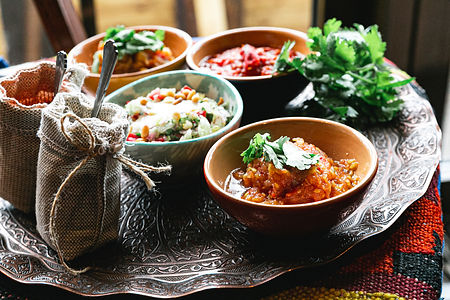 bowls-with-meat-stew-salads-and-spices-4