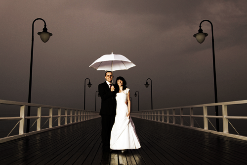 Wedding Couple under Umbrella