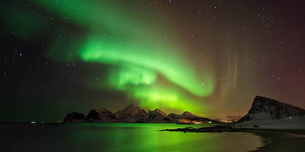 aurora-borealis-above-snowy-island-vestv
