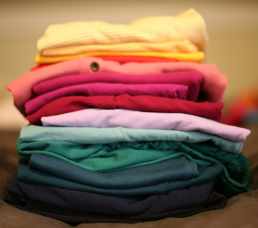 coloured clothes in a pile: The Parents' Guide to