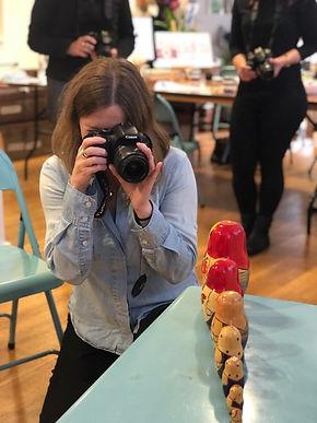 Photo of lady taking photo of Russian dolls Hen School of Art Beginner Digital SLR 2.11.19
