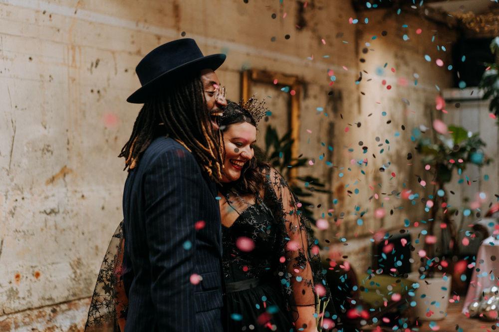 colourful confetti, black wedding dress, stylish groom