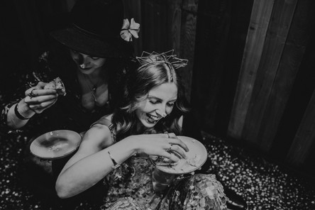 Bride and Groom cake eating. Crown Lucky Sixpence. Image Chloe Mary Photo.