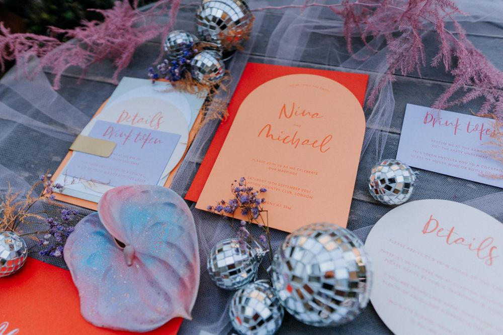 iridescent pastel wedding stationery purple silver orange