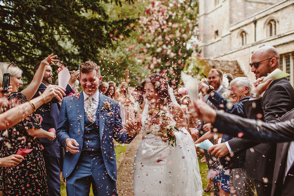 Couple confetti throw bride and groom