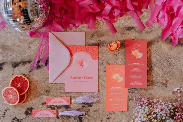 pink and orange wedding stationery