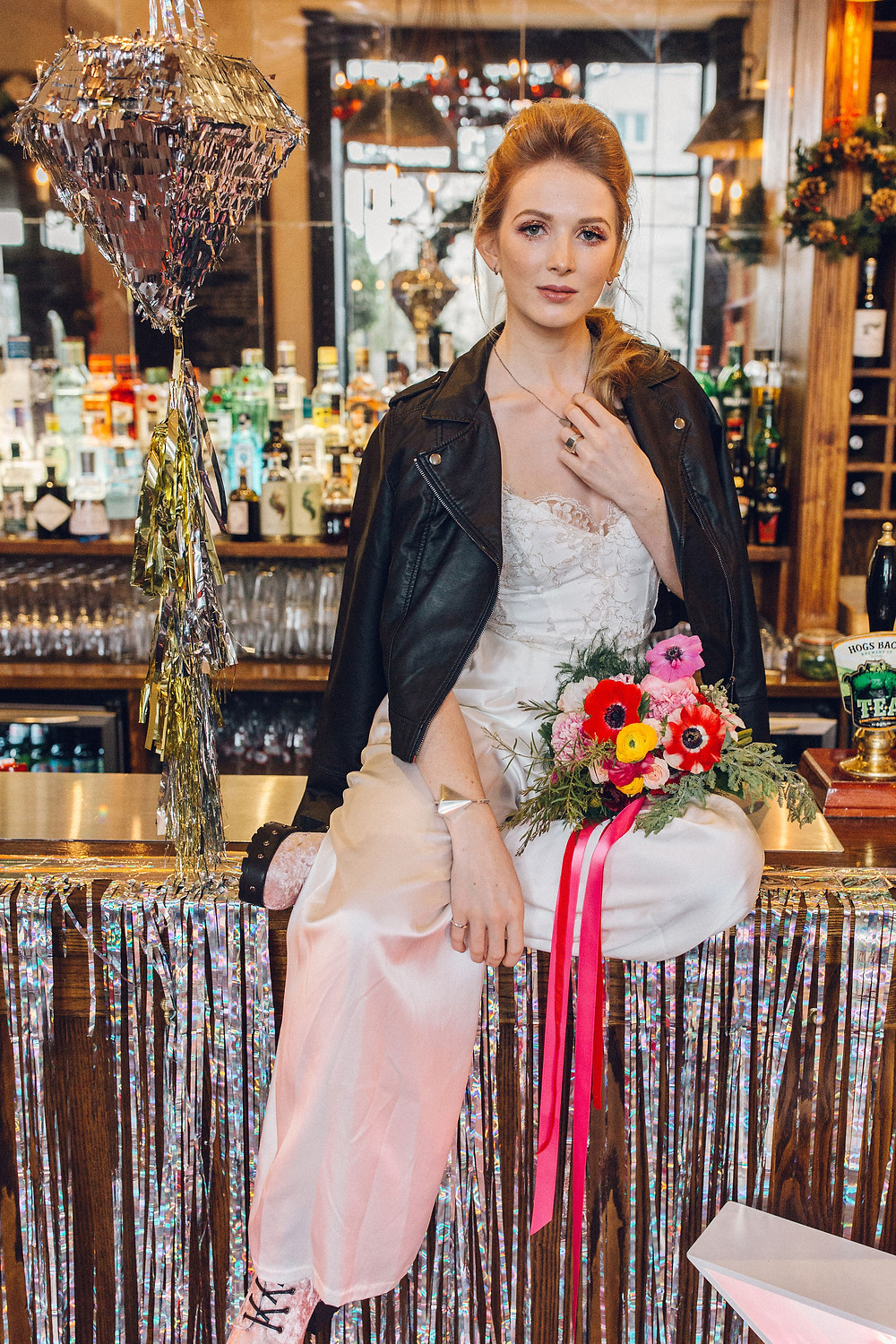 bride leather jacket pinata rock and roll jump the broom