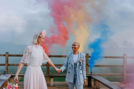 colourful smoke bombs lgbtq couple