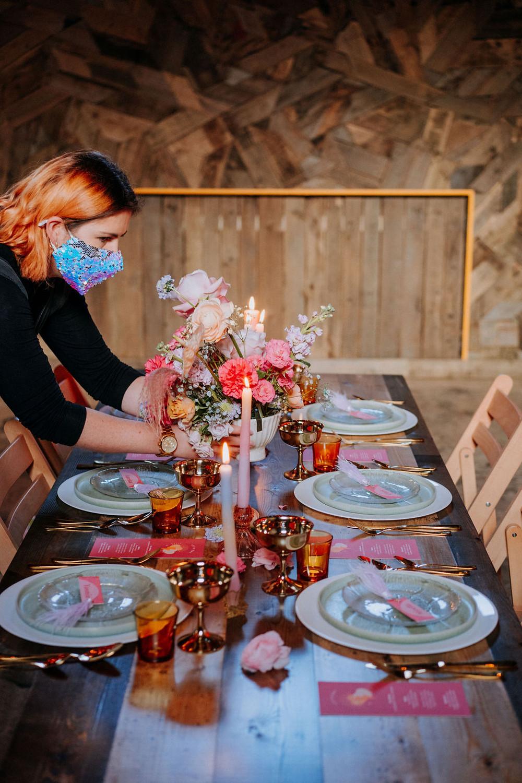 Kate Hirons aka Jump the Broom setting up a colourful wedding table
