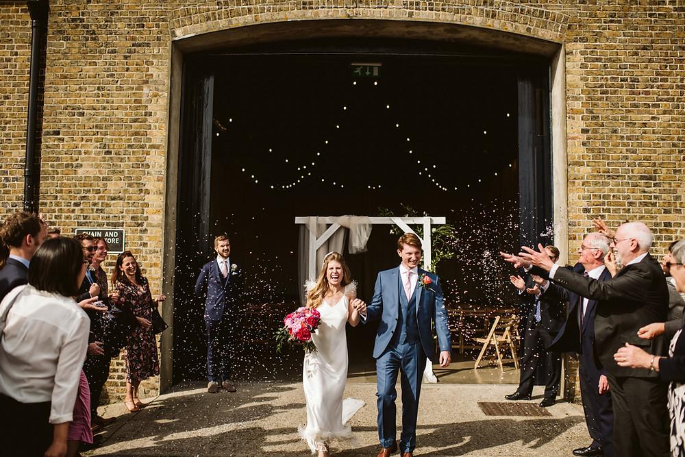 Bride and groom confetti toss at Trinity Buoy Wharf, London