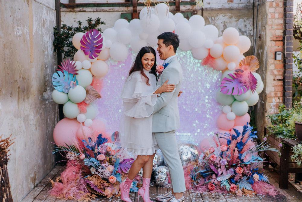 Sequin wedding backdrop, holographic pastels