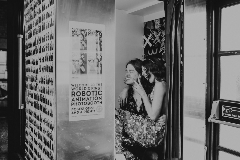Bride and Groom photobooth shot. Jumpsuit Rosa Bloom. Image Chloe Mary Photo.
