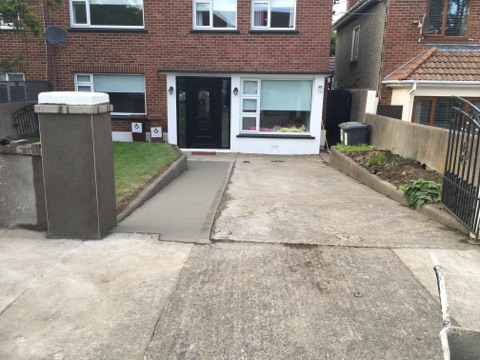 Property Repair Guys 365 drive way works with poured concrete and newly ereceted concrete pillar