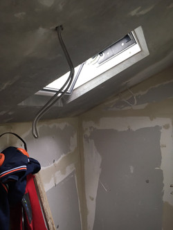 Property Repair Guys 365 Velux window roof installation to bathroom and plastering with electrical w