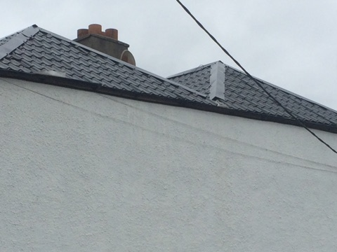 Property Repair Guys 365 Roof works with powder coated roof covering in black finish pitched roof fr