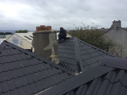 Property Repair Guys 365 Roof works with powder coated roof covering in black finish and new lead gu