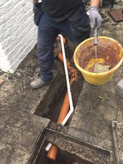 Property Repair Guys 365 Grey Line installation for shower to main drain in garden