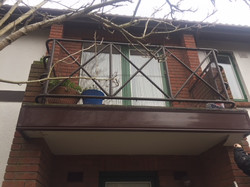 Newly fitted UPVc tan coloured facia boards to balcony Propert Repair Guys 365