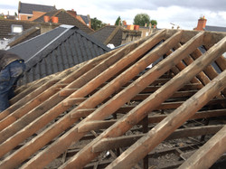 Property Repair Guys 365 Roof works to remove exisiting perished roof tiles