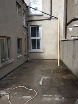 External brick wall after application of lime render Property Repair Guys 365