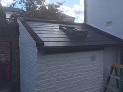 Property Repair Guys 365 Roofing with new slates and installed velux window and white paint finish
