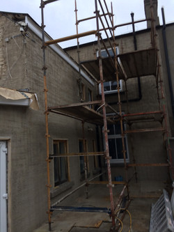 External brick wall during repair and application of lime mix render Property Repiar Guys 365