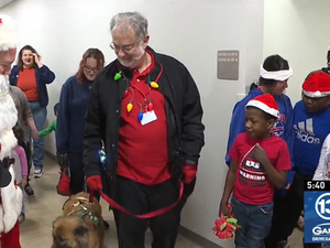Santa, Mrs. Claus, and 'Ally' the therapy dog visit students at Golisano Autism Ceter