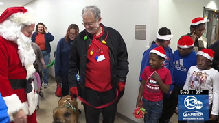 Students at Golisano Autism Center visited by Santa, Mrs. Claus, therapy dog 'Ally'