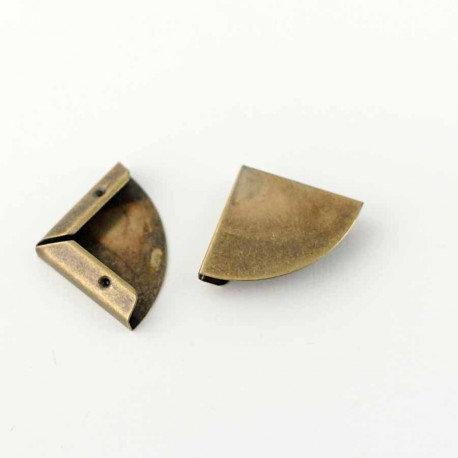 Coin métal arrondi bronze