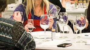 people painting wine glasses